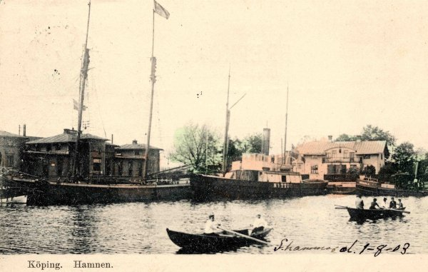 View of the harbour of Köping with the first station building of KUJ to the left, ca 1900